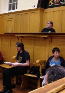 Baron Garrow listens to the witness while Mr Taylor, defending lawyer, looks nervously at his notes
